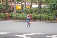 Shenzhen, China: old man crossing the road is very dangerous Stock Photography