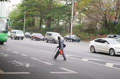 Shenzhen, China: old man crossing the road is very dangerous Royalty Free Stock Images