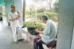 Shenzhen, China: old people singing opera Royalty Free Stock Photos