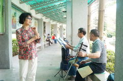 Shenzhen, China: old people singing opera Stock Photography