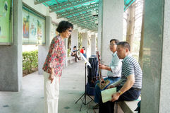 Shenzhen, China: old people singing opera Royalty Free Stock Images