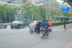 Shenzhen, China: overloading of electric bicycles and hidden dangers Stock Photography