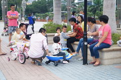 Shenzhen, China: parents and children together to relax and play Stock Photo