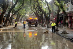 Shenzhen, China: pedestrian street cleaning. Shenzhen Baoan Xixiang commercial pedestrian street, sanitation workers cleaning the road surface in the water stock photography