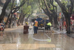 Shenzhen, China: pedestrian street cleaning. Shenzhen Baoan Xixiang commercial pedestrian street, sanitation workers cleaning the road surface in the water royalty free stock photo