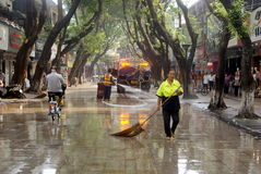 Shenzhen, China: pedestrian street cleaning. Shenzhen Baoan Xixiang commercial pedestrian street, sanitation workers cleaning the road surface in the water royalty free stock photography
