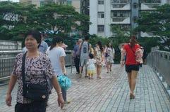 Shenzhen, China: pedestrian visitors Royalty Free Stock Image