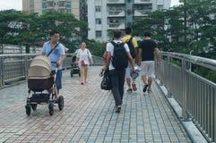 Shenzhen, China: pedestrian visitors Stock Photo
