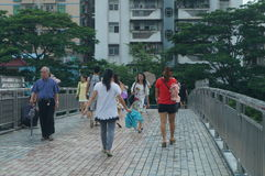 Shenzhen, China: pedestrian visitors Royalty Free Stock Photos
