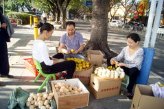 Shenzhen, china: peel oranges Royalty Free Stock Photos