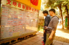 Shenzhen, China: people apply for jobs in an employment agency Stock Photos
