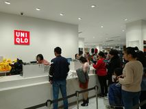 Shenzhen, China: People buy winter clothes in Uniqlo in cold weather royalty free stock image