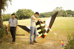Shenzhen, China: people flying kites Stock Image
