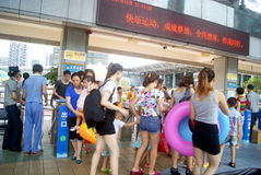 Shenzhen, China: people go to the swimming pool Stock Photo
