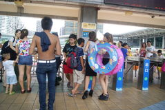 Shenzhen, China: people go to the swimming pool Royalty Free Stock Photo