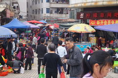 Shenzhen, China: people going shopping in the market. Royalty Free Stock Image