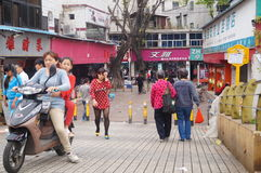 Shenzhen, China: people going shopping in the market. Royalty Free Stock Photo
