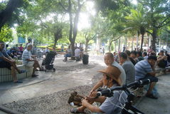 Shenzhen, China: people of leisure parks. Shenzhen Baoan Xixiang Park, people in leisure, some sitting, some singing, some are playing cards, very happy Royalty Free Stock Photography