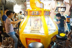Shenzhen, China: people play in the video game room Royalty Free Stock Image