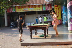 Shenzhen, China: people playing billiards Royalty Free Stock Image