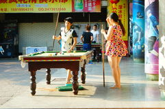 Shenzhen, China: people playing billiards Stock Images