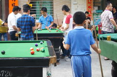Shenzhen, China: people are playing billiards Stock Photo