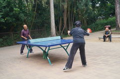 Shenzhen, China: People in playing table tennis Royalty Free Stock Image