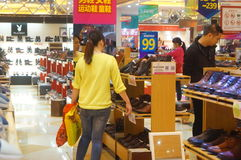 Shenzhen, China: People in the shoe store to buy shoes Stock Photography