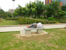 Shenzhen, China: people are sleeping outdoors Stock Photography
