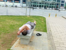 Shenzhen, China: people are sleeping outdoors Stock Image