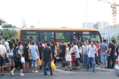 Shenzhen, China: people waiting for the bus Royalty Free Stock Photography
