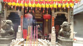 Shenzhen, China: people worship incense in Xixiang`s ancient temple. stock video footage