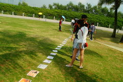 Shenzhen, China: photos of birds, on the lawn, are given away free to tourists. Photos taken by a photographer at the Shenzhen Bay Park on the lawn, if you like Stock Image