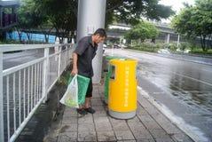 Shenzhen, China: pick up garbage Royalty Free Stock Photo