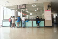 Shenzhen, China: population and family planning service station. Baoan Shenzhen, population and family planning service station. People in the handling of the Stock Photo
