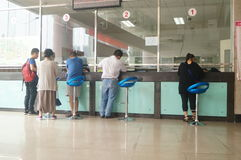 Shenzhen, China: population and family planning service station. Baoan Shenzhen, population and family planning service station. People in the handling of the Stock Photography