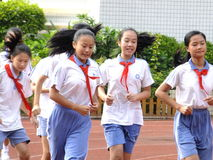 Shenzhen, China: primary school students in the physical education class. Pupils in the physical education class, on the playground, very happy, Shenzhen, china stock photography
