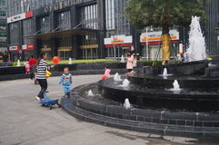 Shenzhen, China: residential district fountain facilities, little children at play Royalty Free Stock Image