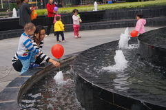 Shenzhen, China: residential district fountain facilities, little children at play Stock Image