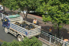 Shenzhen, China: sanitation workers in clearing up the rubbish Royalty Free Stock Image
