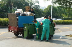 Shenzhen, China: sanitation workers in garbage removal Stock Photography