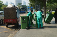 Shenzhen, China: sanitation workers in garbage removal Royalty Free Stock Images