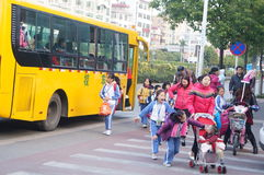 Shenzhen, China: school bus to send their children home Royalty Free Stock Images