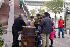 Shenzhen, China: selling baked sweet potato Stock Images