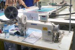 Shenzhen, China: sewing machine and weaving machine Royalty Free Stock Photos