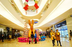 Shenzhen, China: shopping mall interior landscape. Shenzhen Baoan Hai Ya BinfenCheng, the interior of the building landscape, a dog sculpture, etc.. Very Stock Photo