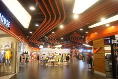 Shenzhen, China: shopping mall interior landscape. Shenzhen Haiya Baoan Binfen City shopping mall interior landscape. This is the clothing area Royalty Free Stock Image