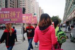 Shenzhen, China: shopping promotions, advertising parade. Shenzhen Baoan Xixiang, Gome mall promotions, consisting of advertising the parade Stock Photo