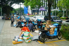 Shenzhen, China: on the sidewalk courier company employees are distributing customer courier royalty free stock photos