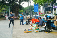 Shenzhen, China: on the sidewalk courier company employees are distributing customer courier Royalty Free Stock Photo